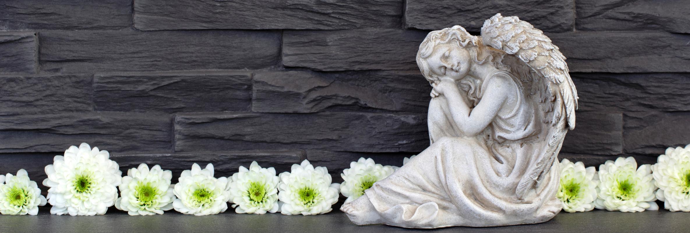Dekofiguren fuer Garten: beschuetzend aus Stein